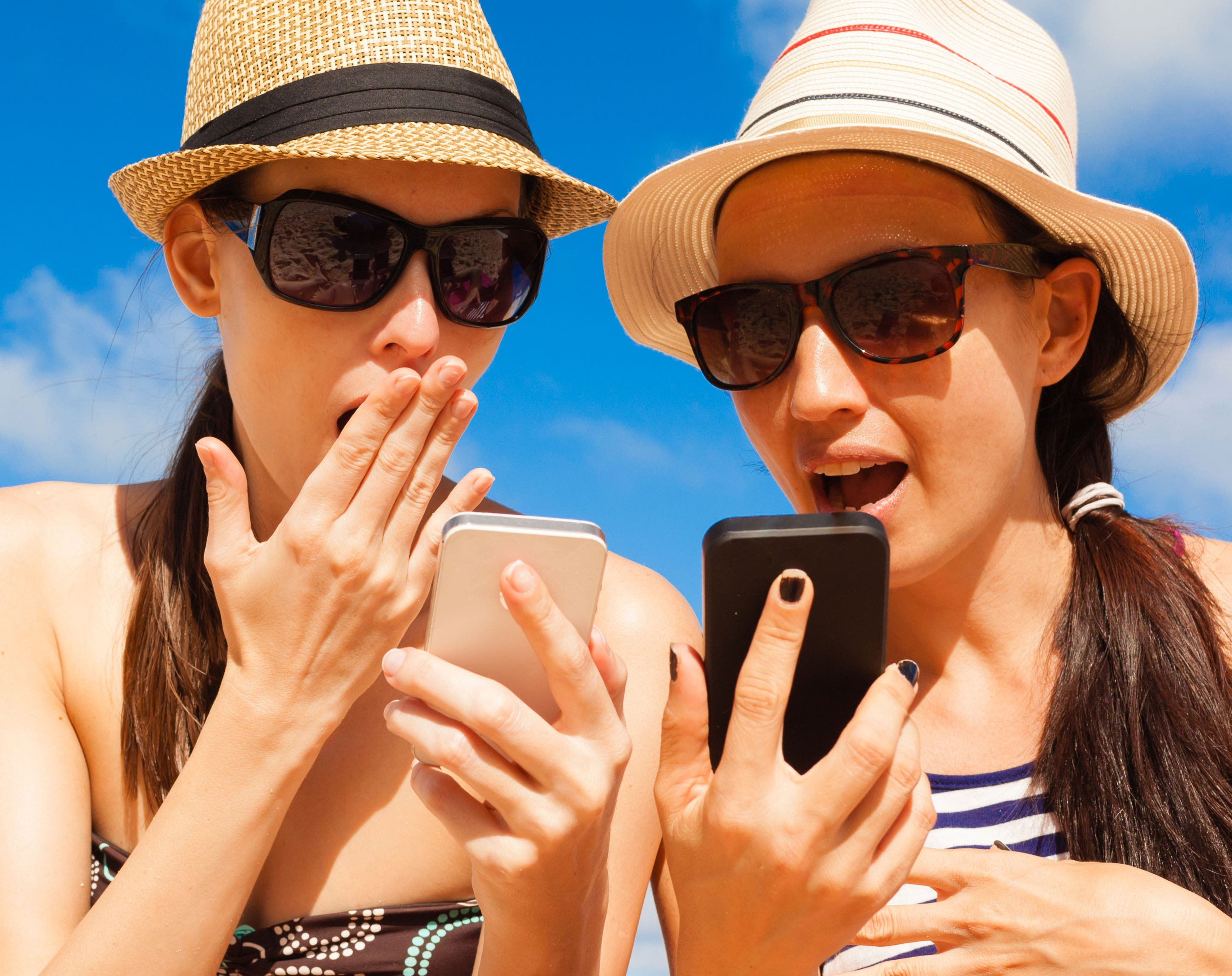 teenagers using iPhones