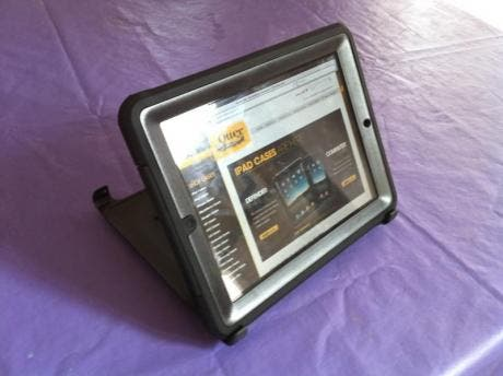 iPad in Defender case propped up by included stand