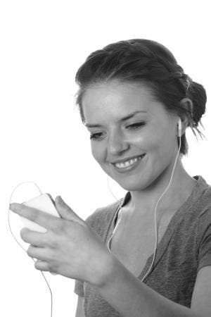 Girl using Apple earphones